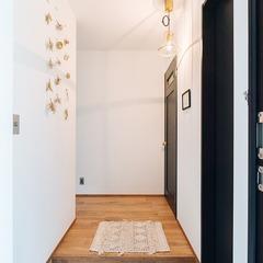 見せない収納で清潔感のある玄関 / 今治市 「歩と円満な家」