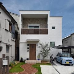 八尾市で建てるレンガのアプローチがかわいいナチュラルなお家