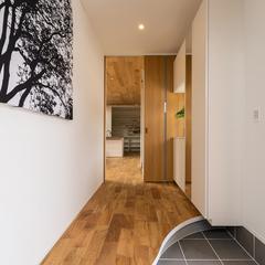 ウェーブの曲線が美しい玄関土間と綺麗に貼ったタイルが自慢の玄関