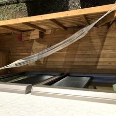 ハンモックで寛げる北欧風ウッドデッキがあるパッシブデザインの家